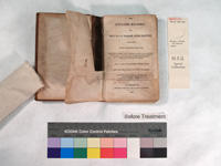 book showing the damage to the textblock, inside the front cover