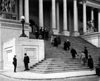 people going up and down the stairs of a government building; (c)2007 Jupiter Images